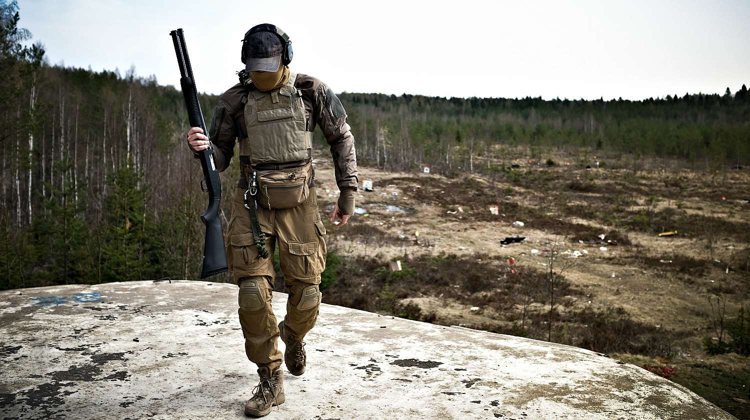 Young militarist man in army uniform with tactical vest | The Tactical Shotgun Scabbard By Beez Combat Systems | Featured