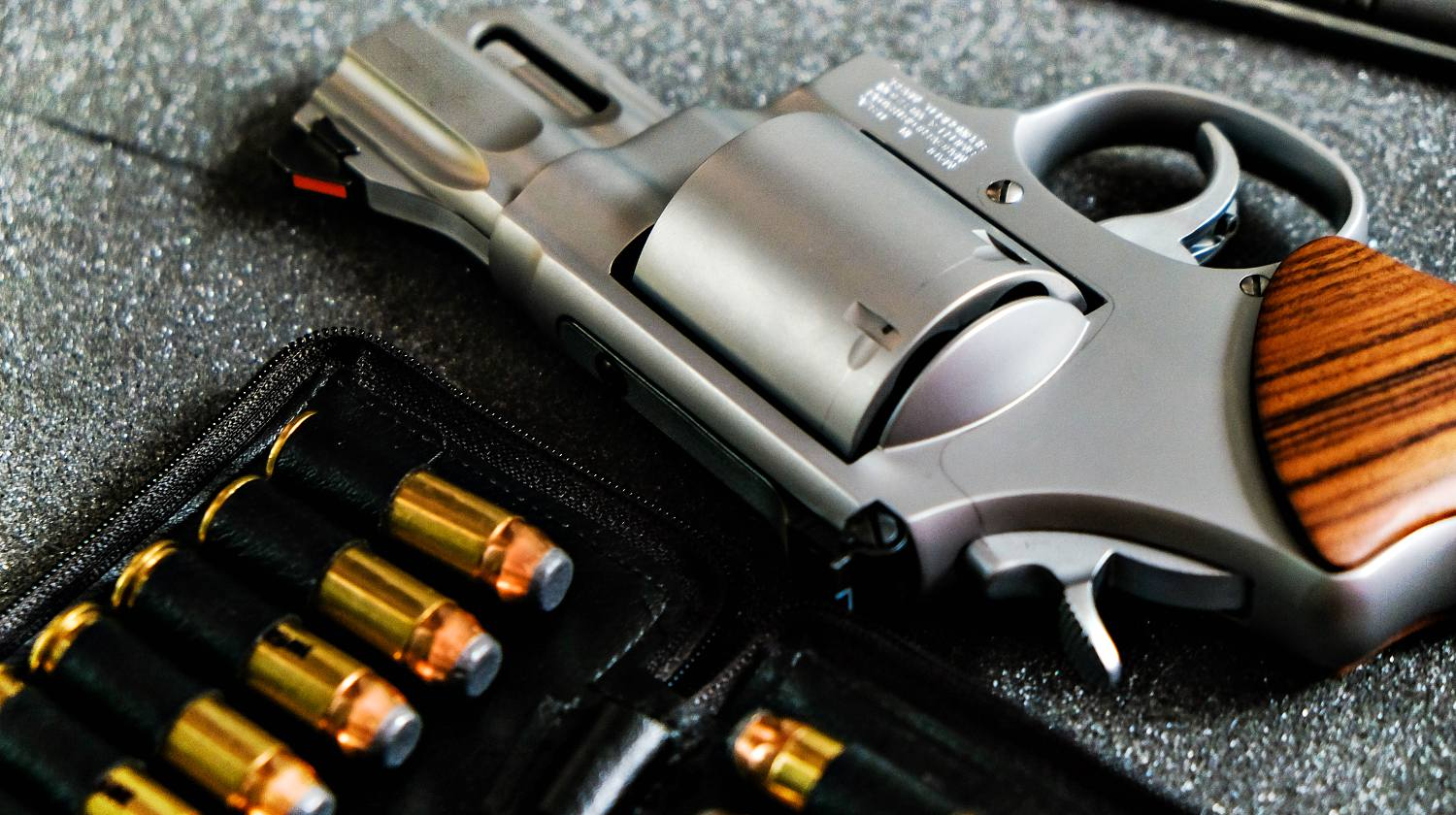 Featured | Metal revolver .44 magnum pistol gun with jacket soft point(JSP) bullet on dark background | The Ultimate Concealed Weapon | Smith And Wesson Model 642