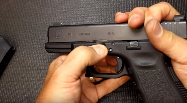 Step 2- Remove the barrel | How To Disassemble A Glock: Step By Step Field Stripping