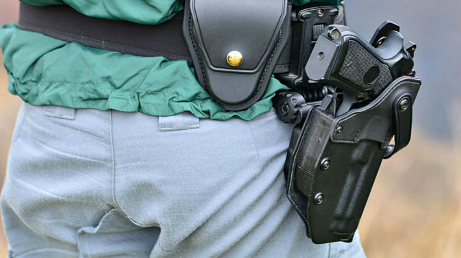 Feature | Man wearing gun holster | The Taurus Pistol Recall: What You Need To Do