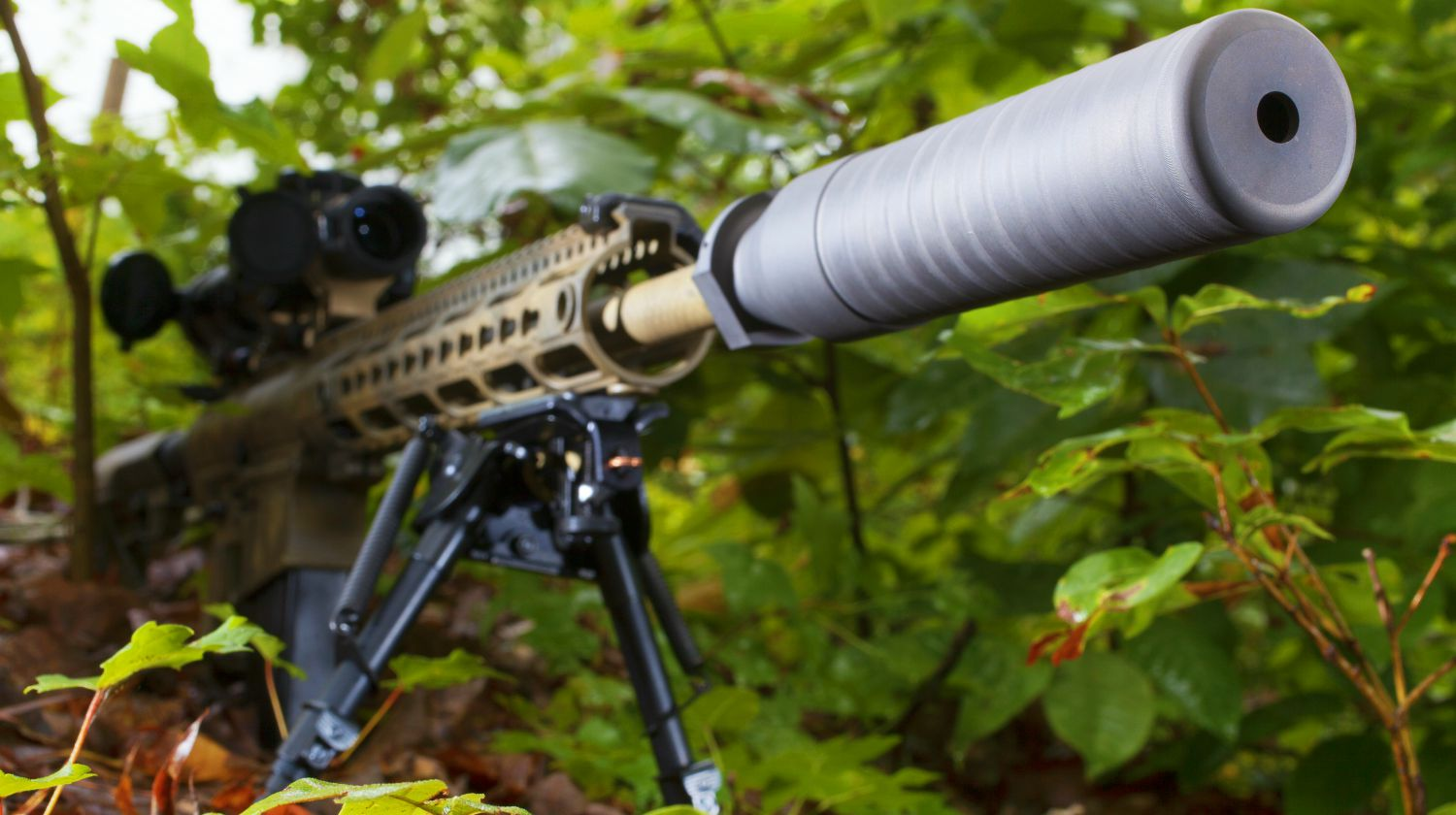 Feature | Semi automatic rifle with a suppressor in the trees | How Do Suppressors Work?