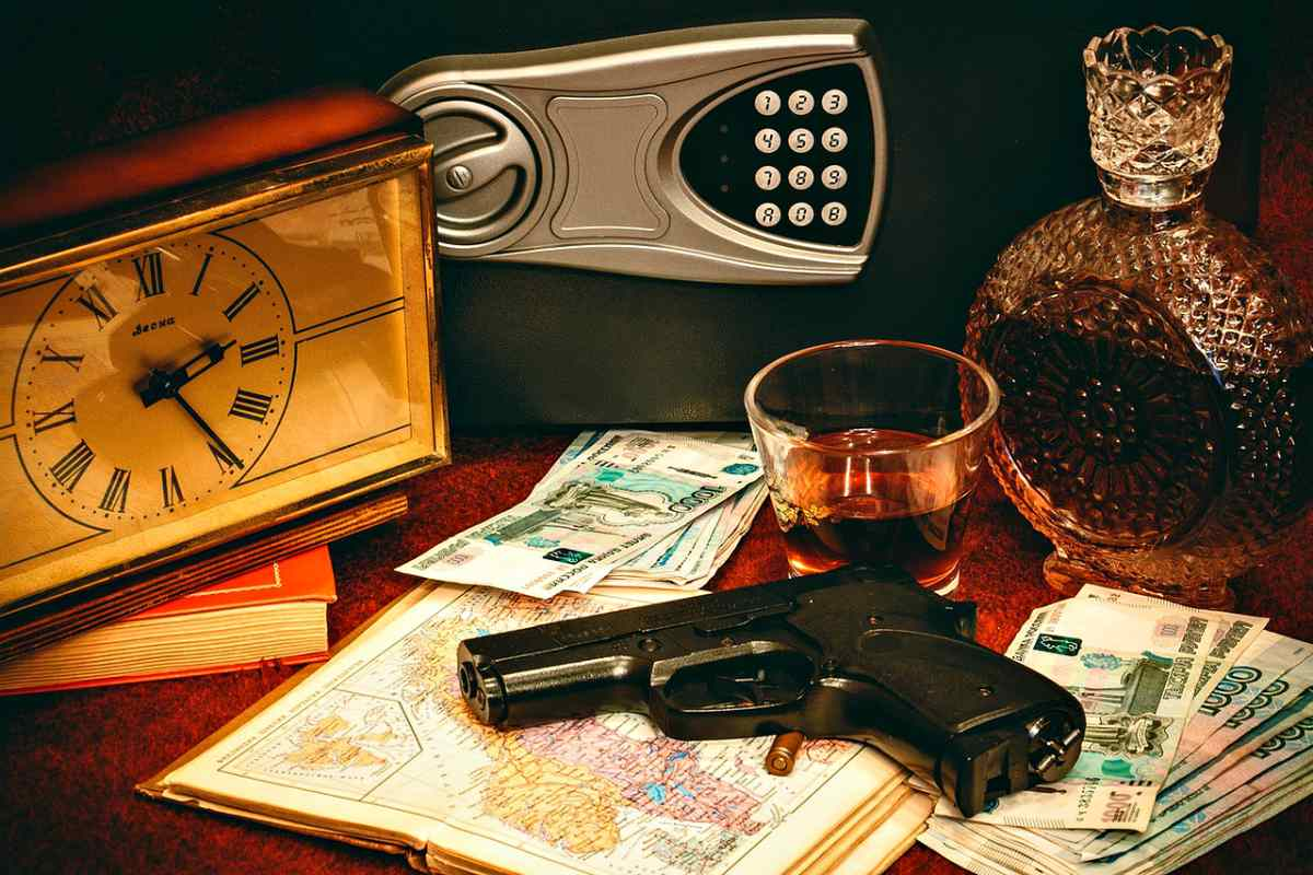 Gun and vault on table   Concealed vs Open Carry: Pros And Cons